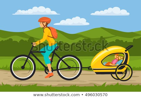 Mother and Daughter Riding on Double Bike. Family Stock photo © robuart
