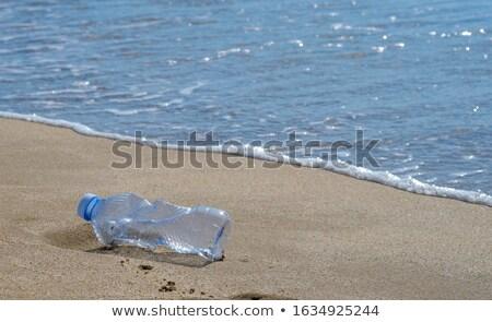 Copy space üres szemét üvegek homok tengerpart Stock fotó © galitskaya