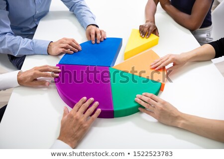 business executives connecting multi colored pieces of pie chart stock photo © andreypopov
