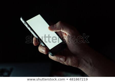 businesswoman with smartphone at night office Stock photo © dolgachov
