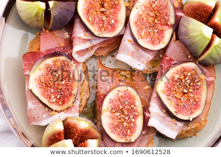Sandwich with prosciutto, fig and olive oil Stock photo © joannawnuk