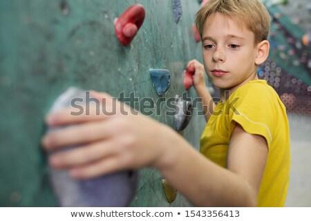 Jeunes écolier jaune tshirt faible Photo stock © pressmaster