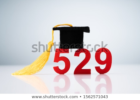 529 Number Showing With Miniature Of Graduation Hat Over Desk Stock photo © AndreyPopov