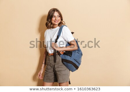Afbeelding charmant tienermeisje rugzak glimlachend Stockfoto © deandrobot