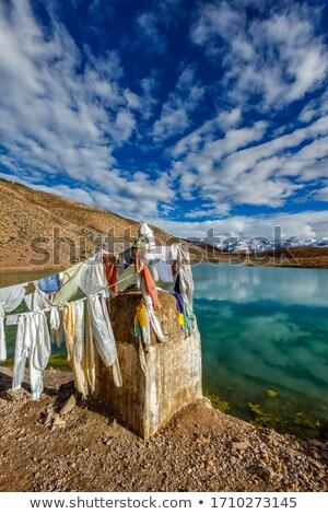 Prayer flags and Dhankar Lake. Spiti Valley, Himachal Pradesh, India Stock photo © dmitry_rukhlenko