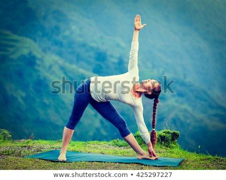 Nő jóga kint háromszög póz vízesés Stock fotó © dmitry_rukhlenko