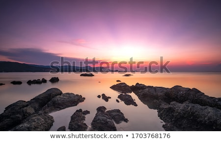 Stock photo: View of the beautiful lagoon at sunset time. Long exposure shot.