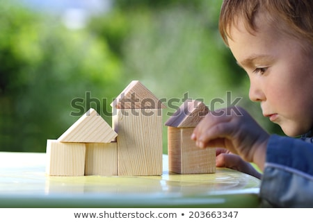 Boy in wooden house Stock photo © simply
