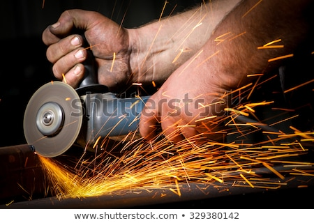 Grinding metal tool with hand Stock photo © dengess