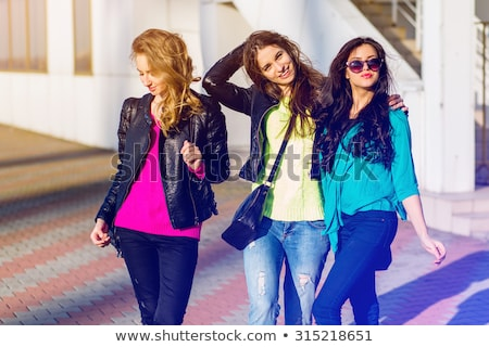 three girls in the autumn park stock photo © massonforstock