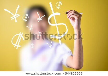 writing currency symbols on a blackboard stock photo © latent