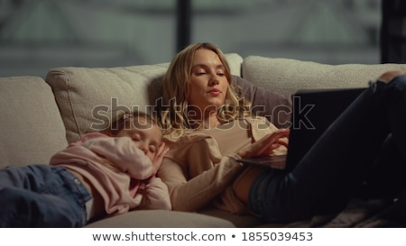 Girl falling asleep next to laptop computer Stock photo © photography33
