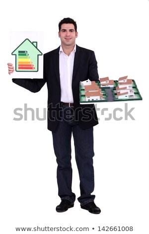 Architect stood with model housing and energy rating information Stock photo © photography33