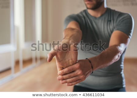 Sportsman stand on out stretched hands Stock photo © vetdoctor