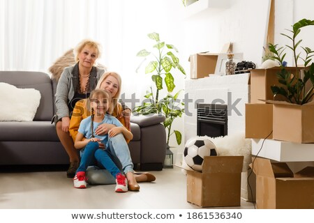 three people surrounded by boxes stock photo © photography33