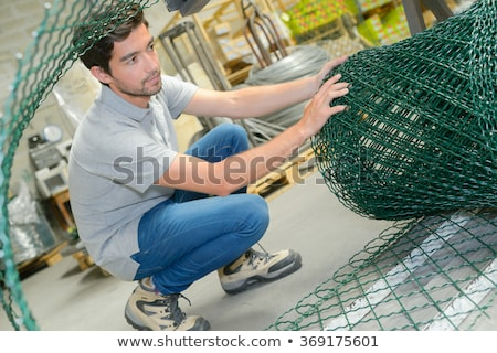 Crouching man unrolling flooring Stock photo © photography33