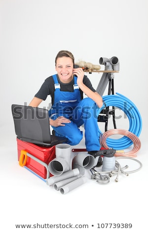 Female plumber knelt down by equipment Stock photo © photography33