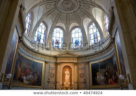 Stained glass window of the church Saint Etienne in Paris Stock photo © jakatics