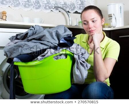 женщину прачечной белый дома фон молодые Сток-фото © wavebreak_media