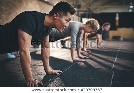 gym man and woman push up strength pushup stock photo © lunamarina