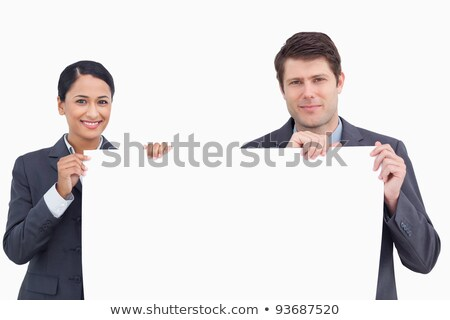Close-up of two young women holding a blank sign against white background stock photo © wavebreak_media