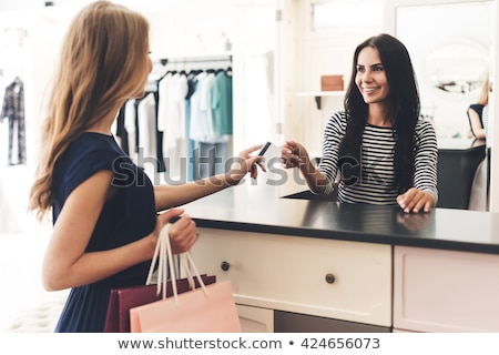 Stock fotó: Woman Paying With Credit Card At Clothing Store