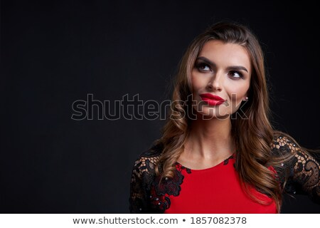 Glamorous woman in red dress looking away Stock photo © wavebreak_media