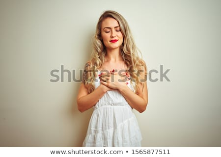 Blond beauty wearing white dress Stock photo © konradbak