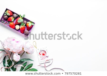 glasses with champagne and red ribbon isolated on white background stock photo © luckyraccoon