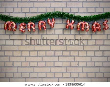 brickwall with writings stock photo © elxeneize