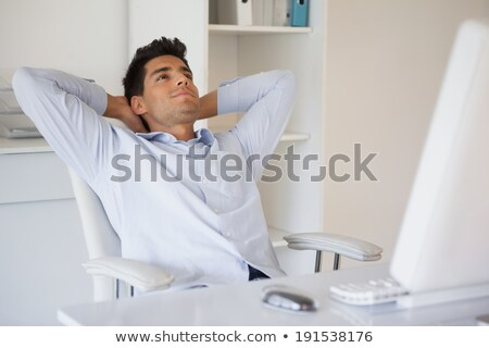 attractive young man leaning back stock photo © feedough