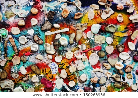part of berlin wall with graffiti and chewing gums stock photo © photocreo