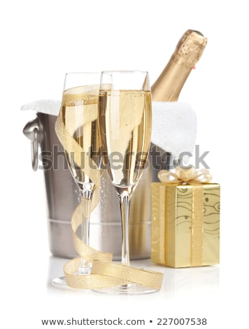 champagne bottle in bucket glasses and gift box stock photo © karandaev