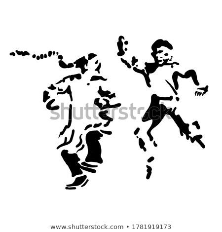 Paintball oyuncular gizleme çim adam spor Stok fotoğraf © Jasminko