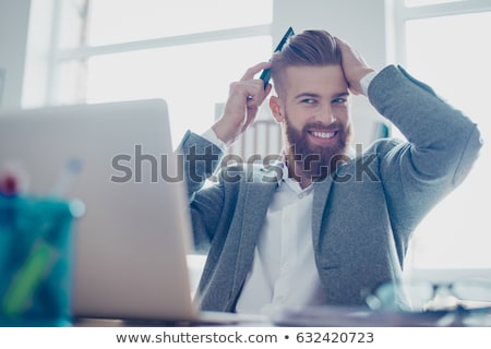 Stock photo: young business man fixes his hair