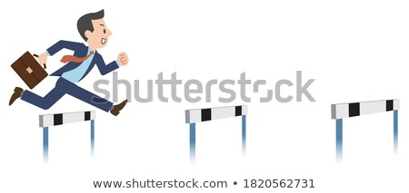 Businessman jumping over a hurdle obstacle. Business concept Stock photo © Kirill_M
