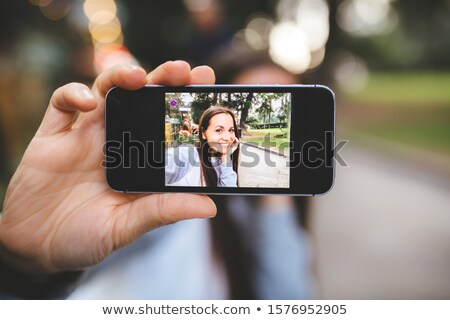 Portrait of beautiful young blonde woman seated at restaurant bar stock photo © user_6981622