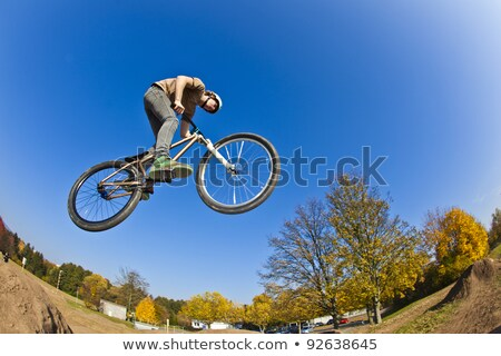 boy going airborne with a dirt  bike Stock photo © meinzahn