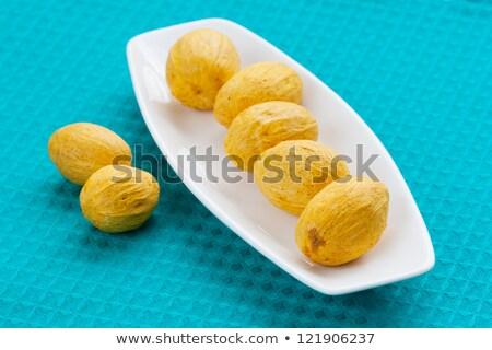 Noix rangée blanche soucoupe nature fruits Photo stock © sfinks