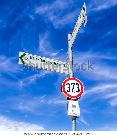 Segnale stradale cielo blu Germania natura segno uccelli Foto d'archivio © meinzahn