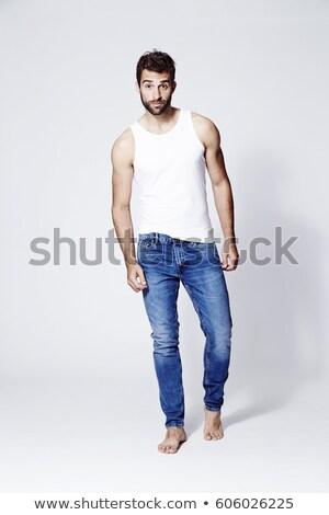 Full Length Portrait of  Confident Barefoot Man in Blue Jeans  Stock photo © meinzahn