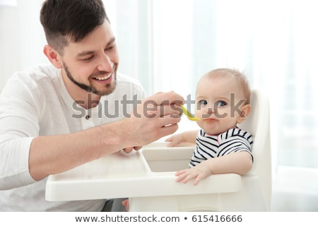 Daddy feeding toddler Stock photo © d13