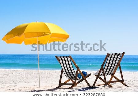 sun loungers with umbrellas on the beach stock photo © franky242