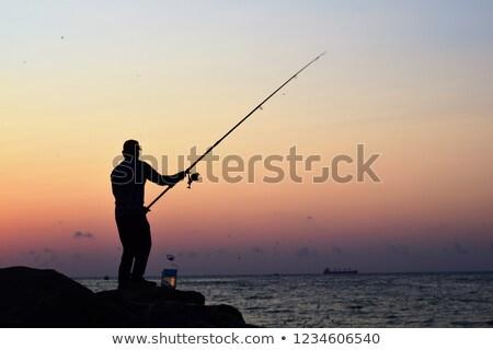 Silhouettes of fishing people Stock photo © olandsfokus