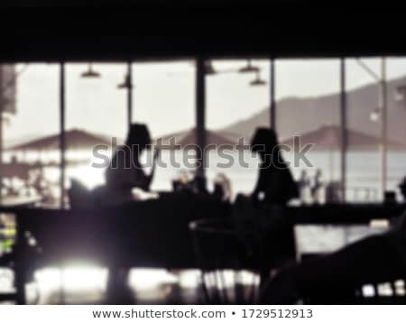 Stock photo: couple silhouettes near table