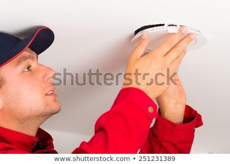 elettricista · soffitto · lampada · fili · maschera - foto d'archivio © barabasa