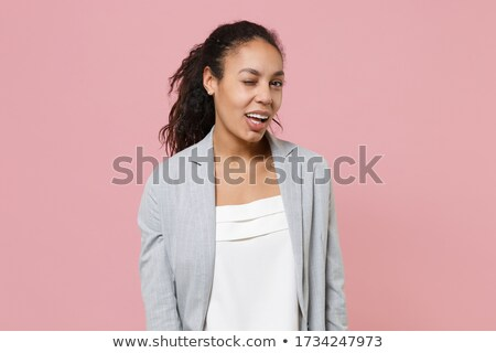 African business woman blinking eye stock photo © phakimata
