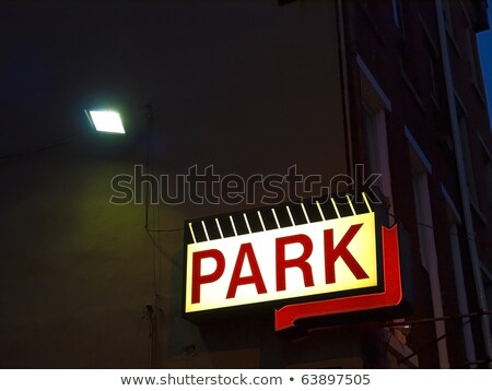Lighted Neon Park Sign Downtown Parking Garage Arrow Stock photo © cboswell