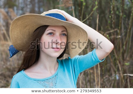 Freckled girl in hat on windy day Stock photo © Agatalina