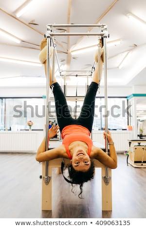 Pilates mulher acrobático exercer ginásio saúde Foto stock © lunamarina